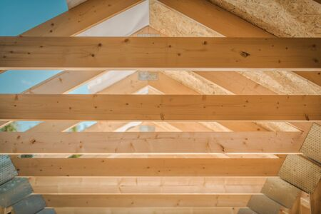 Home Roof Wood Beams. Wooden Structure. House Developing. Construction Industry Theme.