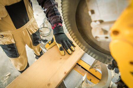 Circular Saw Wood Work Closeup Photo. House Building. Industrial Theme. Home Improvement Concept. Stock Photo