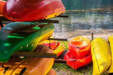 Colorful Lake Kayaks Rental Place. Summer Water Recreation. Sport Theme. Stock Photo