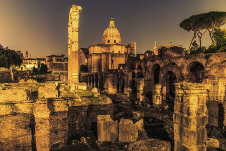Roman Forum Ruins at Night. Ancient Government Buildings in the Center of Rome, Italy. Stock Photo