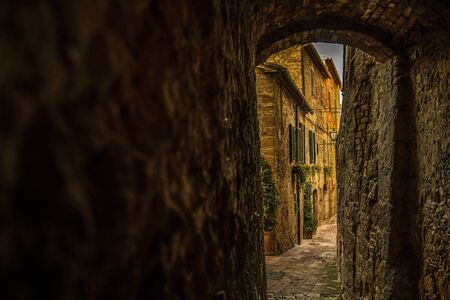 Narrow Italian Village Streets. Pienza in the Center of Tuscany Region of Italy. Left Side Copy Space.