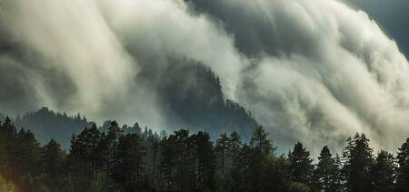 Panoramic Photo of Waterfall Orographic Clouds in Julian Alps, Slovenia. Meteorological Phenomena. Weather Theme. Stock Photo