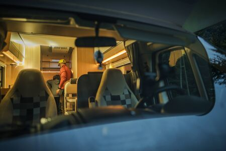 Caucasian Family in RV Class C Motorhome. Sleeping in Camper Van. Father Showing His Daughter Motorcoach Interior.