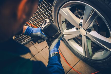 Vehicle Tires Replacement and Wheels Balancing. Automotive Industry.