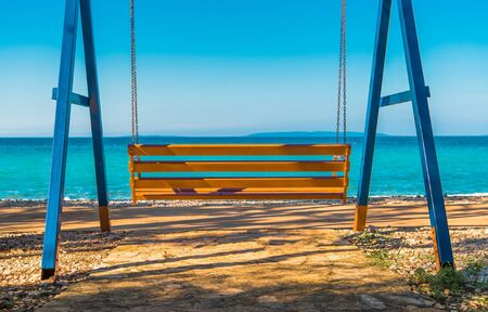 Sea Front Swinging Bench. Relaxing Outdoor Place.