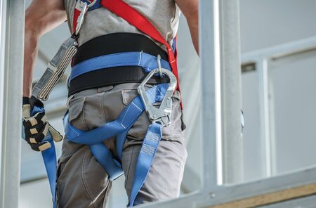 Construction Safety Equipment. Industrial Worker Wearing Safety Harness. Closeup Photo. Фото со стока