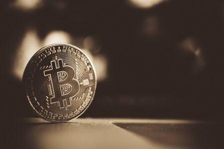 Golden Blockchain Coin. Metal Bitcoin Closeup. Cryptocurrency Theme.