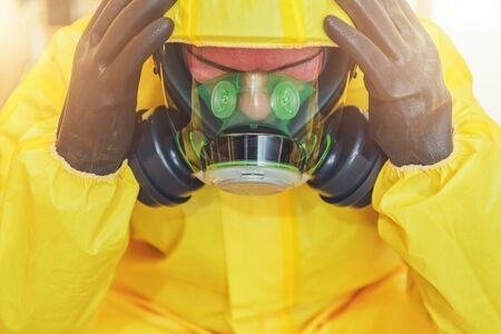 Frustrated Hospital Worker in Biochemical Gas Mask and Chemical Protective Hazmat Suit