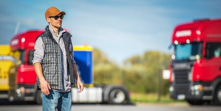 Transportation Industry. Caucasian Male Semi Truck Driver in His 30s on the Truck Stop.