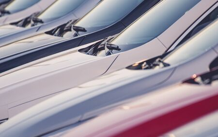New Vehicles For Sale. Line of Cars Awaiting Clients. Dealership Lot. Automotive Industry.