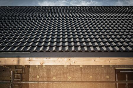View Of Gray Roof Tile In Newly Constructed House.