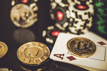 Close Up Of Small Stack Of Casino Chips And Golden Bitcoins With One Laying On Top Of Red Diamond Ace Card.