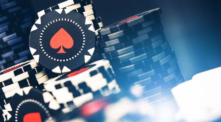 Close Up Of Multiple Stacks Of Casino Poker Black And White Chips With Red Spades Image.