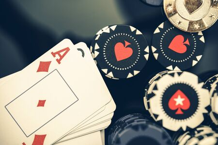 View Of Stack Of Playing Cards With Ace On Top And Bundle Of Casino Poker Chips.