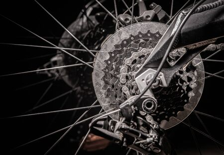 Close Up Of Bicycle Back Wheel With Metal Discs Spikes Chain And Gears.