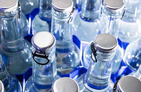 Fresh Sparking Mineral Water Close Up Photo. Drinking Water in Glass Bottles.