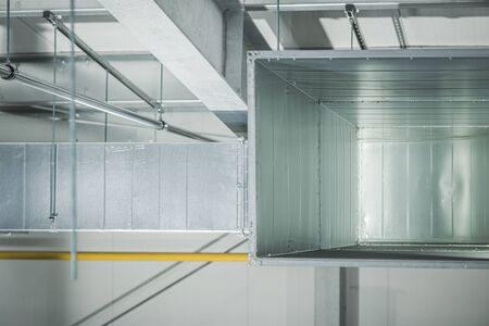 Warehouse Commercial Air Vent Distribution Canal Made From Metal. Building Heating and Cooling System.