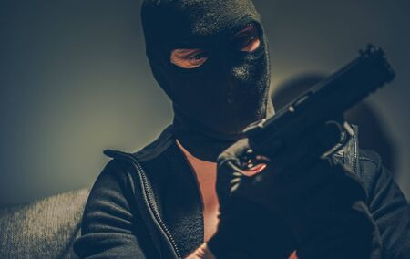Dangerous Gangster with Hand Gun Wearing Balaclava Mask Preparing For Another Crime. Concept Photo. Stock fotó