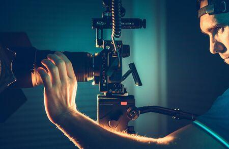 Caucasian Videographer. Professional Camera Operator with Pro Digital Equipment Taking Indoor Video Shots For Documentary Short Film. Stock fotó
