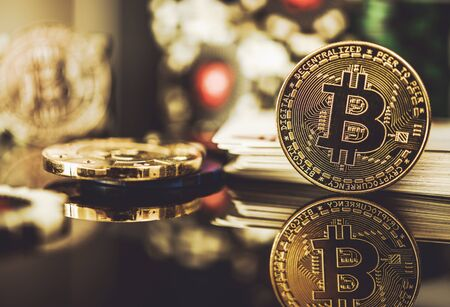 Close Up Of Golden Bitcoin As Casino Payment With Playing Cards And Poker Chips In Background.