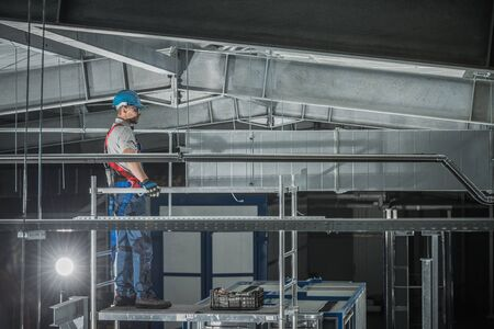 Cool And Hot Air Distribution Shaft Installation Inside Of Warehouse Building. Stock fotó