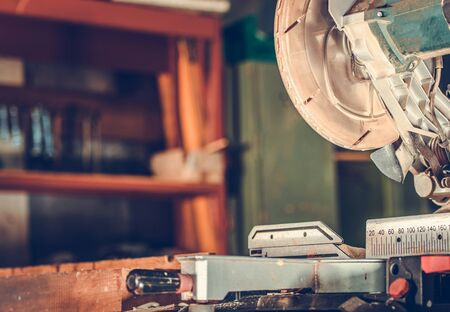 Close Up View Of Electric Chop Saw With Circular Blade Designated To Cut Wooden Material Inside Of Workshop.