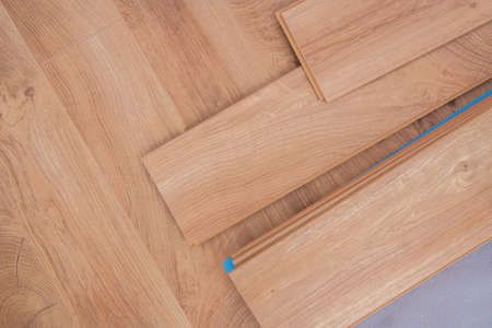 Laminated Residential Floor Panels Close Up. Flooring Industry Theme. Wooden Like Material.