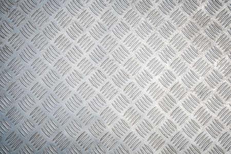 Industrial Background. Metal Diamond Plate Known As Chakkered or Tread Plate. Metallic Pattern. Stock fotó