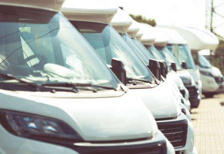 Line of Brand New Camper Vans Motorhomes Awaiting Clients on Dealership Sales Lot. Recreational Vehicles Selling. Caravaning Industry.