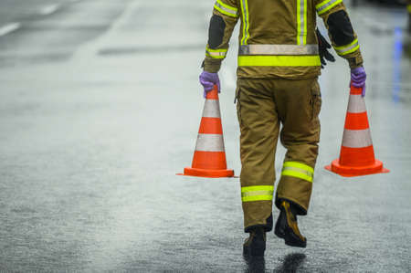 Transportation System Theme. Highway Worker Preparing For Road Closure Moving Two Traffic Cones. Transport Industry.