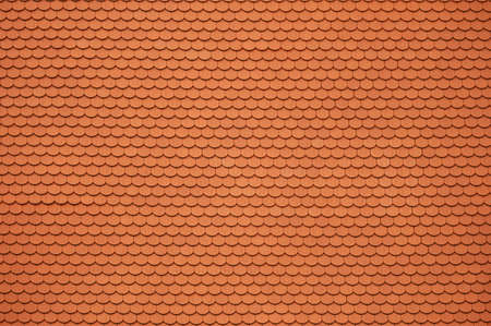 Orange Ceramic Roof Tiles Background. Tile Pattern. Architectural Roofing Material. 写真素材