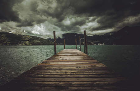 Italian Lombary Region Lake Iseo Stormy Weather and the Wooden Pier. Also Known as Sebino. Italy, Europe. Stock Photo