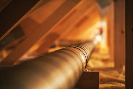 HVAC Industry Theme. Wooden Attic Structure Installed Metal Air Shaft. Pipeline to Distribute Fresh and Clean Air in the Many Home Corners.