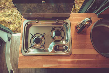 Camer Van Appliances. Recreational Vehicle RV Stove and Kitchen Area. Cooking in Motorhome.