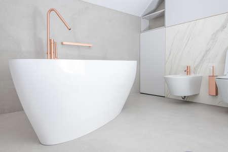 Modern Elegant White Standalone Acrilic Bathtub and Bathroom Interior in the Apartment.