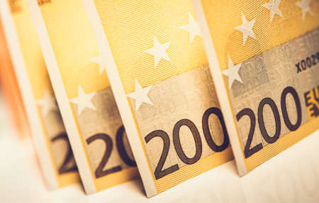 Banking and Financial Theme. Two Hundred Euro Banknotes Close Up Photo.