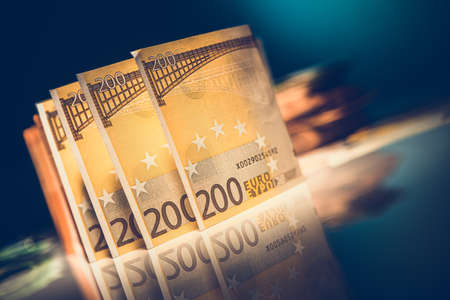 Two Hundred Bills Euro Banknotes on Glassy Table. European Banking System and Economy Theme. Imagens