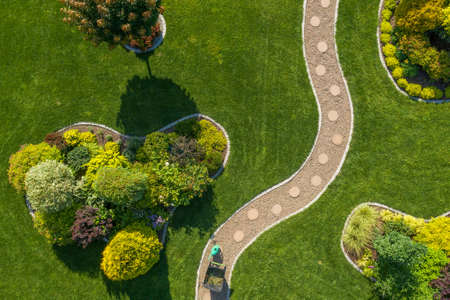 Mature Residential Backyard Garden with Large Grass Lawn Aerial Top View. Gardening and Landscaping Industry Theme. Summer Time. Imagens