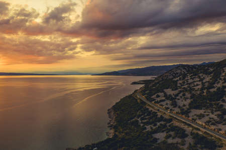 Aerial Photo of Mediterranean Sea and Northern Croatian Coastline with Scenic Route During Summer Sunset. Croatia, Europe.