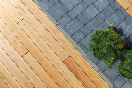 Garden Architecture Materials. Wooden Deck and Concrete Bricks Pavement in a Garden Top View.