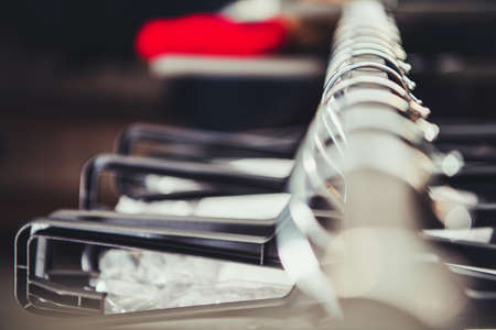 Retail Store Clothing Garment Rack Shallow Depth of Field. Clothing Industry Theme
