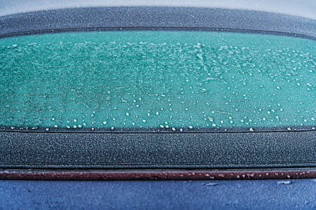 Frozen Rear Car Window Close Up. Transportation and Winter Season Challenges.