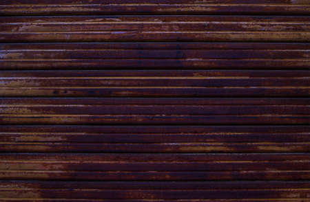 Rusty Piece of Metal Photo Backdrop. Aged Metallic Material Background.