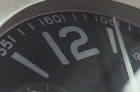 Close up of twelve o'clock wall clock