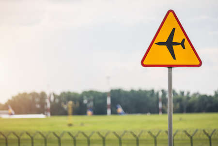 Airport Zone Watch For Low Passing Aircrafts. Yellow Warning Traffic Sign Near the Airfield. Transportation Theme.