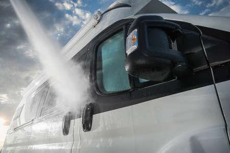 Summer Season Preparation. Pressure Washing RV Camper Van Close Up. Recreational Vehicle Maintenance. RV Industry. Reklamní fotografie