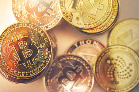 Few Golden Cryptocurrency Coins Like Bitcoin, Tron and Z-Cash Close Up. Modern Financial Theme.