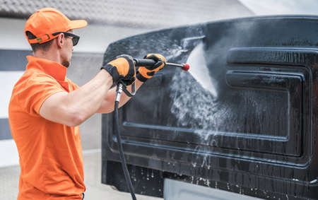 Caucasian Men in His 40s Pressure Washing Back of His Truck Cabin in a Car Wash. Vehicle Maintenance. Reklamní fotografie