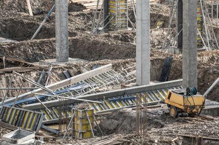 Commercial Building Construction Site. Concrete Columns and Steel Reinforcements. Industrial Theme.