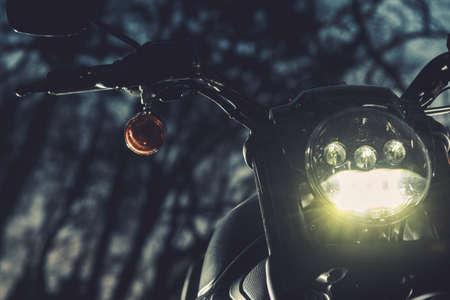 Motorcycle Night Ride Theme. Bike Front Headlight Close Up. Transportation Theme.